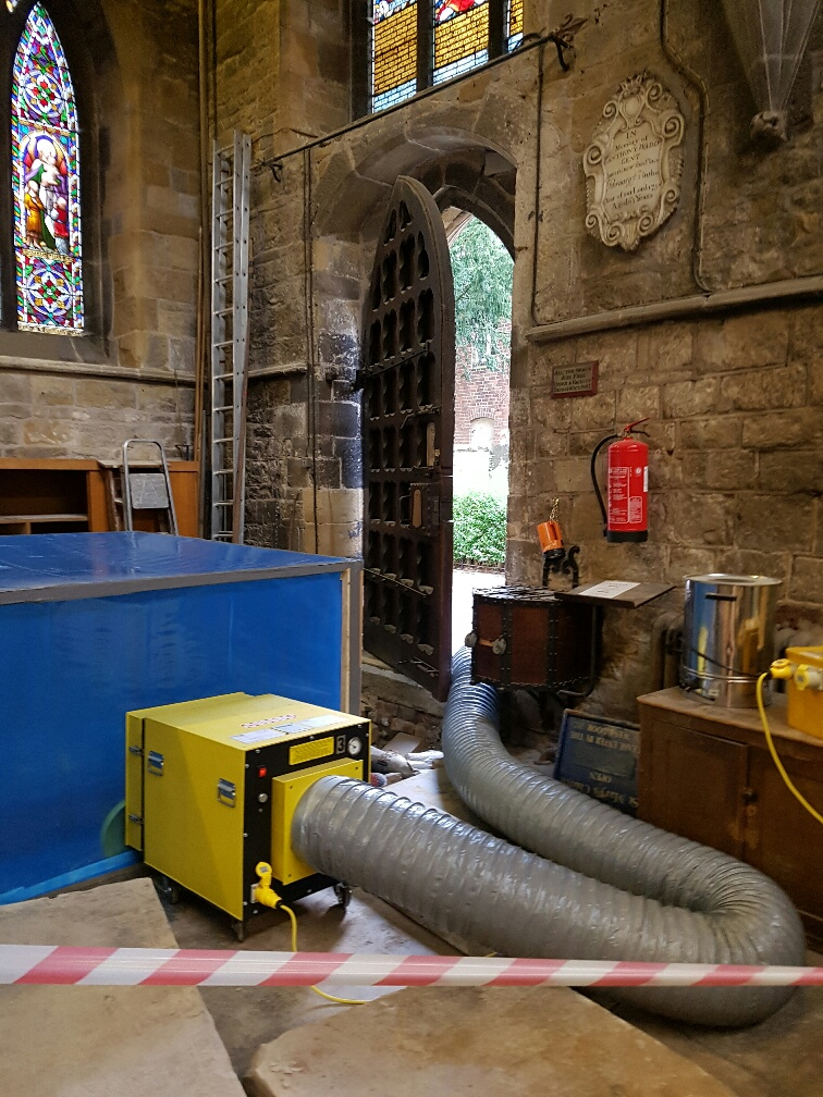 equipment set up in a church to remove asbestos.