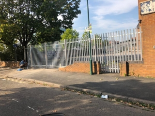 silver metal security fence around a commercial premises, fitted by Croft Environmental Services