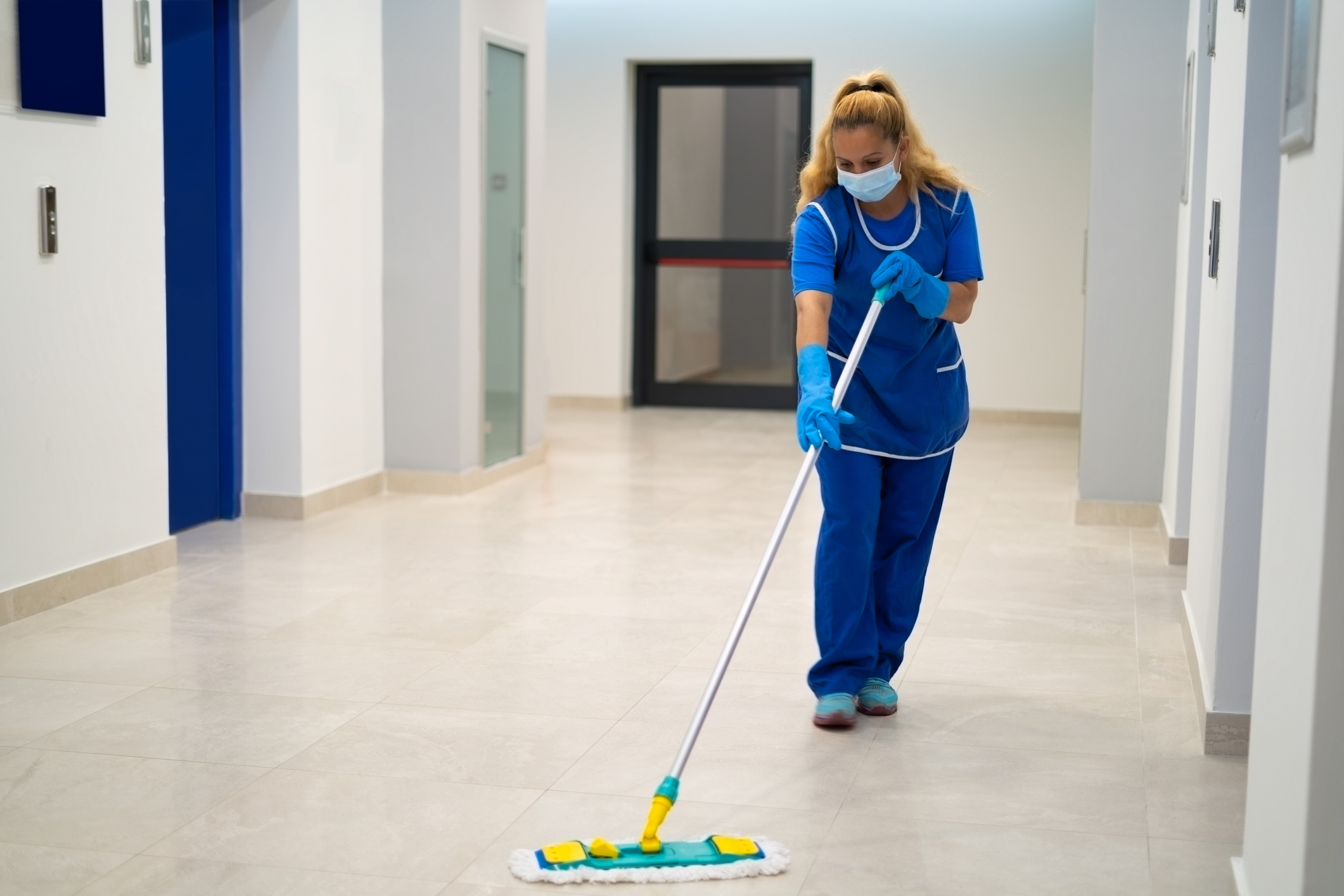A commercial cleaner form Croft Environmental cleaning floor tiles in a commercial building