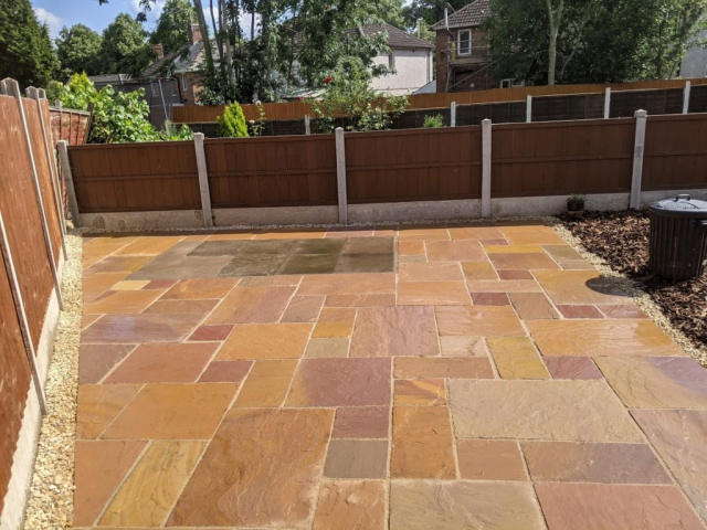 Domestic garden with new paving and wooden fencing by Croft Environmental